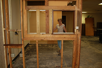Barbara Groeber, Respect Life's director of education, marks the front of what will be the reception area at the future home of the main Respect Life Office, at 4747 Hollywood Boulevard in Hollywood.