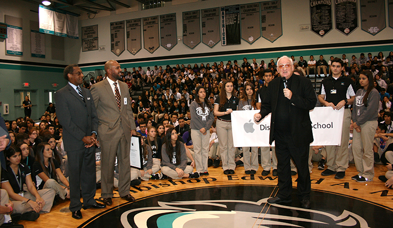 Father Dalton speaks to McCarthy High's student body following the Apple Distinguished School presentation by Apple representatives.