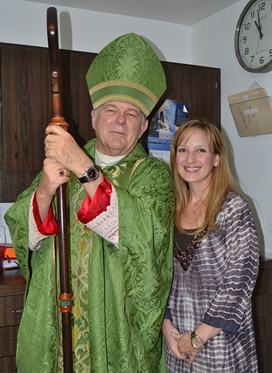 Archbishop Wenski poses with Katie Blanco Crocquet, president of the Archdiocese of Miami Development Corporation, before the ThanksForGiving Mass.