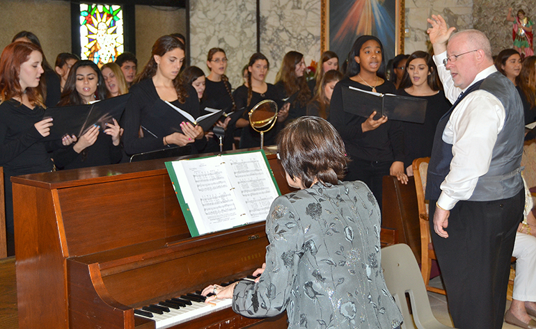 The St. Thomas Aquinas High School Choir/Chorale sings at the ThanksForGiving Mass, on Nov. 16 at St. Clement Church, in Broward. Conducting was the school's theology instructor, Michael McCormack, with choral director Wanda Drozdovitch on piano.