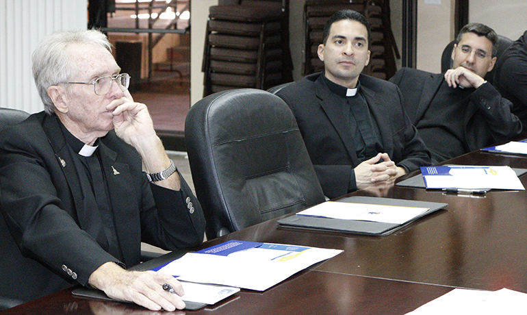 From left, Father Michael Hoyer, pastor of St. Gregory Church, Plantation, Father Jose Alfaro, pastor of Blessed Trinity Church, Miami Springs, and Father Manny Alvarez, pastor of Immaculate Conception, Hialeah, listen during the orientation session for implementation of the Synod pastoral plan.