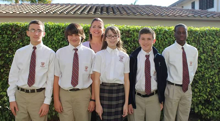 Team members Ethan Clerkin, Austin Hamawy, Shannon Vogel, Logan Paolillo and Samuel Alexander won $ 100 scholarships to Cardinal Gibbons High School. They are pictured with teacher Kathy Aprea-Cook.
