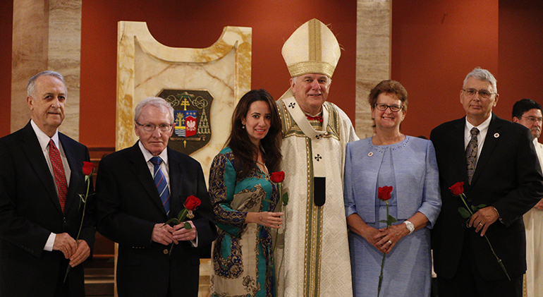 Newly-inducted members of the Archbishop Coleman Carroll Legacy Society pose for a photo with Archbishop Thomas Wenski; from left: Salvatore Difede, John Dietl, Smilka Meldoza representing Vivian Decker, a posthumous honoree, and Kevin and Sandra Davis.
