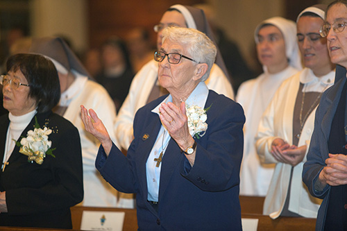 Sister Mary Patricia Hale, of the Sisters of Notre Dame de Namur, who was celebrating 70 years of religious life, prays The Lord's Prayer.