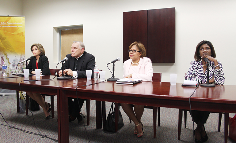 Panelists at the FIU discussion on immigration reform were, from left: Helen Aguirre Ferre, journalist and political anylist; Archbishop Thomas Wenski, a member of the U.S. bishops' Committee on Immigration; Dahlia Walker-Huntington, immigration attorney; and Gepsie Metellus, executive director of the Sant La Haitian Neighborhood Center.