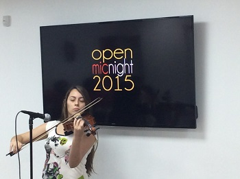 Junior Gabriela Gutierrez plays the violin at the Msgr. Pace High Literary Guild's annual Open Mic Night inside the school's Innovation Center.