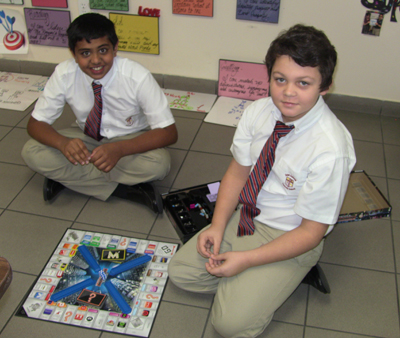 With the opportunity to buy McDonald's, Sony, Coca-Cola and other big-named brands, Adam John and Ronald Stock could not wait to play Monopoly Empire. Adam and Ronald, along with other St. Andrew School students, joined in the fun of playing non-electronic games as a part of Global Challenge Game Day.