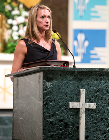 Johanna Saxton Shields, a member of the St. Thomas More Society of South Florida, reads prayers of the faithful at the annual Red Mass April 23 at St. Anthony Church in Fort Lauderdale.