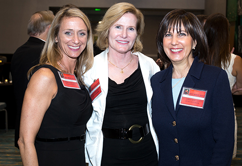 Johanna Saxton Shields, left, poses with Judge Laura Watson and  Catherine Favitta, members of the St. Thomas More Society in South Florida, following the annual Red Mass April 23 at St. Anthony Church in Fort Lauderdale.