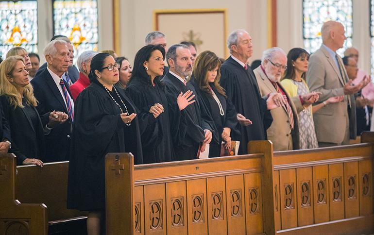 Taking part in the Red Mass at Gesu Church, front row, from left: Circuit Judge Bertila Soto, Circuit Judge Beatrice Butchko, Circuit Judge Milton Hirsch, Circuit Judge Samantha Ruiz-Cohen, Appeals Court Judge Vance Salter, Circuit Judge Jorge Rodriguez-Chomat.
