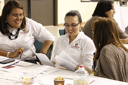 Parish staff engages in role-playing at the workshop to learn the best way to react to challenging situations; from left: Karla Pacheco, Carolina Jaramillo and Yaneth Mutis of St. Boniface Church in Pembroke Pines.
