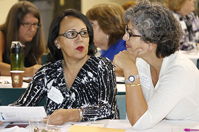 Maria Elena Salazar,left, of Assumption Parish in Lauderdale-by-the-Sea and Belkis Ferrer of St. Katharine Drexel in Weston engage in role-playing at the workshop to learn the best way to react to challenging situations.