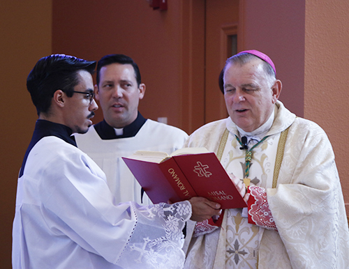 Archbishop Thomas Wenski celebrates Mass before blessing the Latino Americans: 500 Years of History exhibit at the Archbishop John C. Favalora Archive and Museum inside the St. Thomas University Library Sept. 8, 2015.