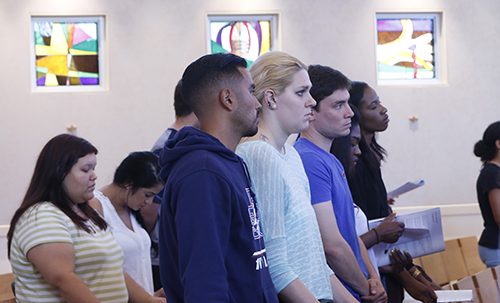 St. Thomas University students pray during the Mass in St. Anthony Chapel.