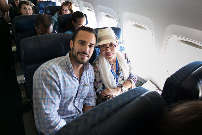 """Marta Mohr and her son, Leonardo """"Felice"""" Gorordo, pose for a photo on the plane that would take her to Cuba for the first time since her exile in 1969."""