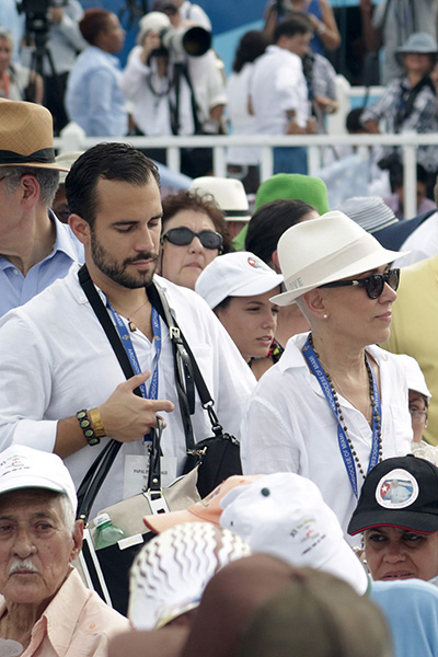 """Leonardo """"Felice"""" Gordo and his mother, Marta Mohr, take part in the papal Mass in Havana's Plaza de la Revolucion Sept. 20. She received a personal blessing from Pope Francis after the Mass ended, before he left the area."""