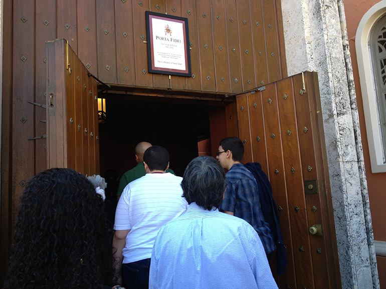 People enter St. Mary Cathedral's Holy Door during the Year of Faith in 2013. That same door will soon be re-opened for the Year of Mercy.