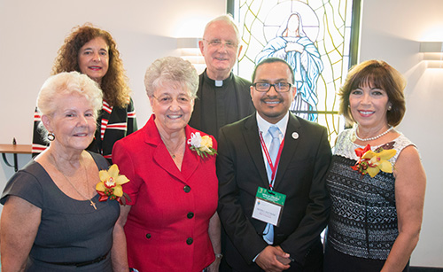 The 2015 catechetical awards recipients pose in the chapel of St. Thomas Aquinas High School. From left: Rose Young, Esperanza Ginoris Award winner;  Adrian Dominican Sister Joan Leo Kehn of St. Gregory Parish and Vilma Angulo, winners of the Lifetime Catechetical Leadership Award; back row: Kim Pryzbylski, senior director of Faith Formation for the archdiocese; Msgr. Vincent Kelly, supervising principal of St. Thomas Aquinas High; and Peter Ductram, director of the Office of Catechesis.