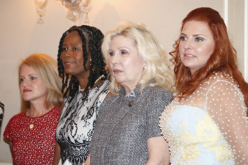 Four of this year's Women of Faith honorees wait to be called to receive their medallions; from left: Maria Arazoza (grace), Myriam Mezadieu (compassion), Mariana Martinez (radiance) and Maria Simosa (charity).