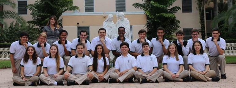 Sitting before the Holy Family statue donated by the 2002 inaugural class are Archbishop Edward A McCarthy High School students recognized in 2016 for their academic achievements by the National Merit Recognition Program and the National Hispanic Recognition Program. Sitting, from left: Veronica Roach, Lara Suarez, Alessandro Benadia, Monica Diaz, Andres De La Fe, Alec Arritola, Jenna Tingum, Rebecca Vargas. Kneeling, from left: Sebastian Fuentes, Alexander Smith, Savaughn Cannady, Alejandro De La Cova, Daniel Soto, Jonathan Delva, John Albury, Michael Perez, Matthew Salas, Andres Samos and Ronald Geis. Standing behind themn is Adriana P. Murgueytio, director of Guidance and Counseling at McCarthy High.