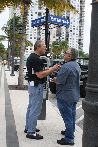 St. Paul Street Evangelization member, David Babbin, left, spreads the Gospel message to a receptive pedestrian.