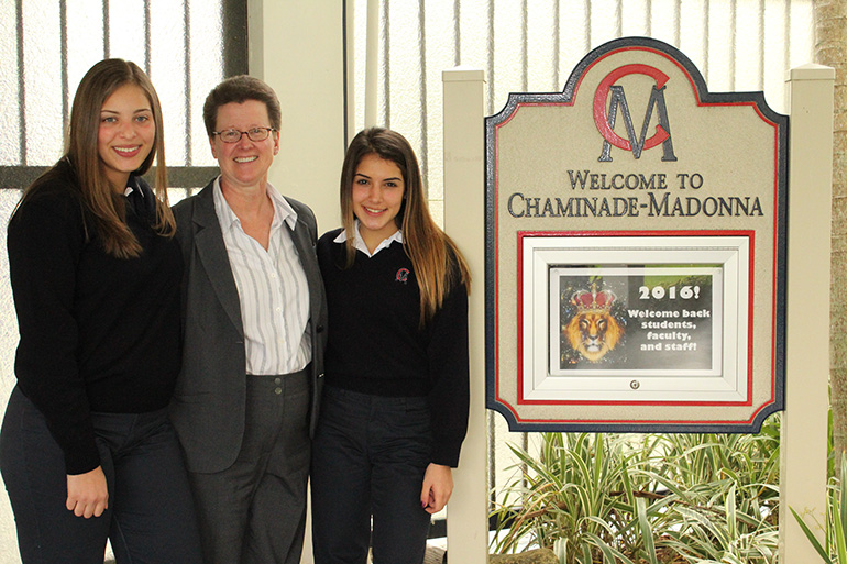 Bella's Kinship Group creators Isabella (left) and Gabriella (right) Glazer pose with Chaminade-Madonna College Preparatory President Judith Mucheck. Bella's Group was recognized by the Congressional Coalition on Adoption Institute as one of the 2015 Angels in Adoption. The non-profit serves as a support and social group for children being raised by their grandparents or other familial guardian.