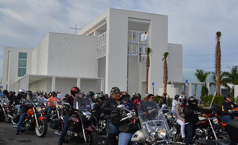 Motorcyclists set out from Our Lady of Guadalupe Church grounds on the 2016 Archbishop's Motorcycle Ride.