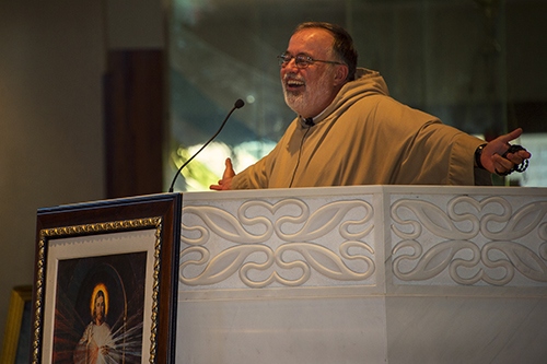 Father Philip Scott, of the Congregation of St. John, preaches the homily during the Mass that was celebrated during the one-day Women of Grace conference.