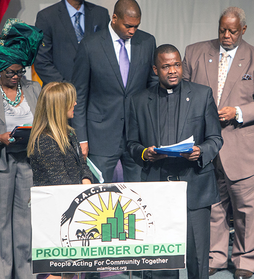 Msgr. Chanel Jeanty, president of PACT and pastor of St. James Church, addresses the PACT assembly.
