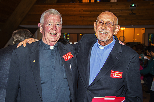 Father Thomas O'Dwyer, pastor of Little Flower Church in Hollywood, poses with Father Roger Holoubek, pastor of St. Maurice at Resurrection in Dania Beach.