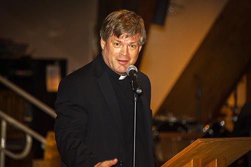 Father Steven O'Hala, pastor of St. David Church, speaks at the Nehemiah Assembly.