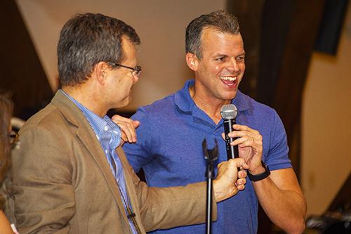 Pastor Keith Spencer of Trinity Lutheran Church hands the microphone to Broward County Mayor Marty Kiar.
