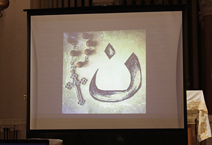 """This is the symbol for the letter """"Nun"""" in Arabic, the first letter in the word """"Nazarene."""" It has become a symbol for the persecuted Christians in the Middle East."""
