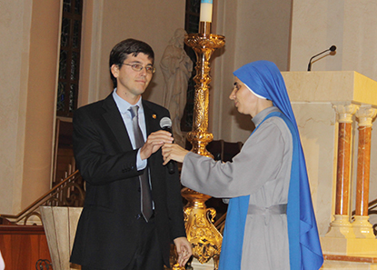 Sister Maria Guadalupe Rodrigo hands the microphone to Francisco Ruiz Guiñazú, of the Argentinian law offices Estudio Garrido, who are carrying out a campaign to help the persecuted Christians in the Middle East.