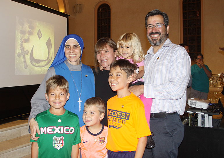 The Borjon family, parishioners at St. Patrick, pose for a photo with Sister Maria de Guadalupe Rodrigo, of the Congregation of the Incarnate Word, after her talk at the church April 20. From left, top: Sister Guadalupe and Abril, Victoria and Ricardo Borjon; below, from left, Rico, Patricio and Leonardo Borjon.