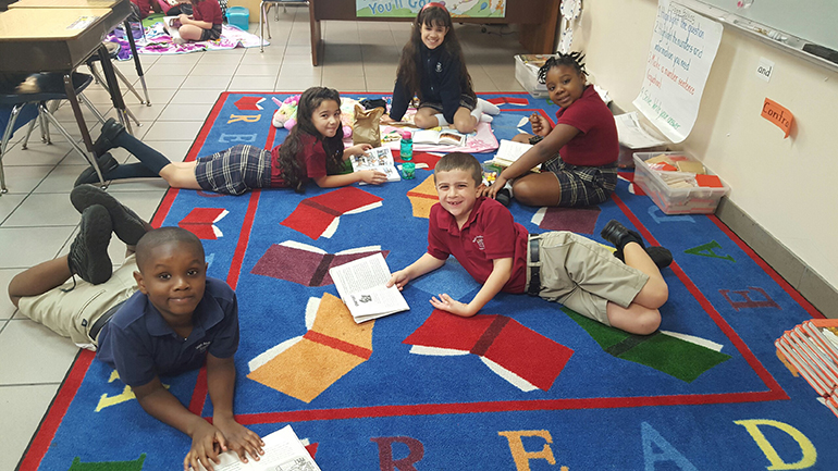 Read-a-thon: St. Andrew School kindergarteners, along with first and second graders, joined for a Read-a-thon fundraiser to raise funds for a water pump for St. John Vianney School in Flint, Michigan.