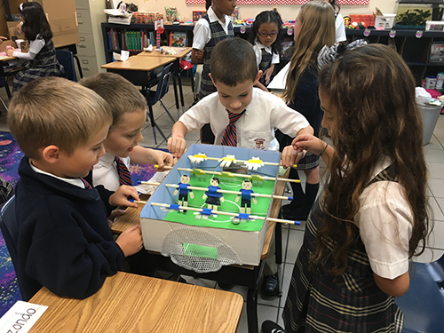 It's game time: St. Andrew School second graders raise funds for a water pump for St. John Vianney School in Flint, Michigan by hosting a Game Day.