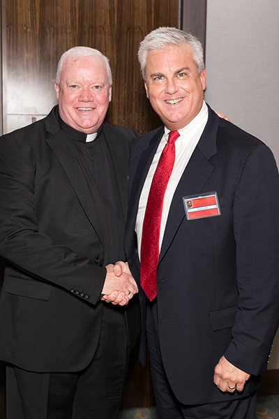 Father Patrick Naughton, parochial vicar at St. Gregory the Great Church in Plantation, poses with attorney W. Anthony