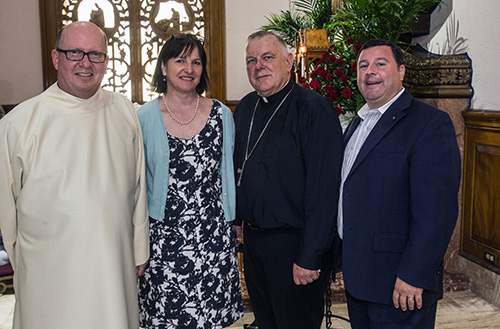 Father Michael Davis, Little Flower's pastor, poses for a photo with Janet Graffius, collections curator at Stonyhurst College, England, Archbishop Thomas Wenski and Stephen Colella, cabinet secretary of Parish Life in the archdiocese.