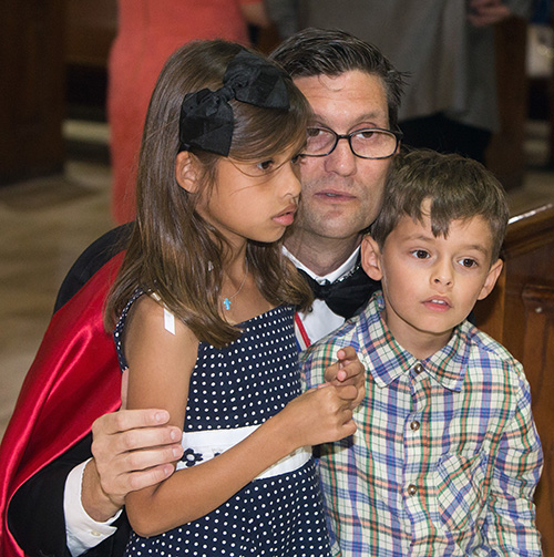 Knight of Columbus Daniel Biggs, III, brings his children, Victoria Biggs, 7, and Daniel Biggs, IV, to see the relics of St. John Fisher and St. Thomas More.
