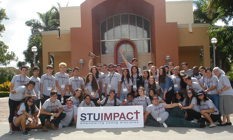 STU Impact students pose for a group photo outside of the St. Thomas University chapel. From June 17-24 students lived on campus and participated in the STU Impact summer theology institute.