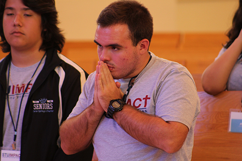 Participants of STU Impact pray during the closing Mass of the theology summer institute.