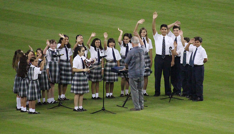Members of the Church of the Little Flower/St. Theresa School Honor Choir wave after singing the national anthem Aug. 26 at Marlins Park, before a game between the Miami Marlins and the San Diego Padres.