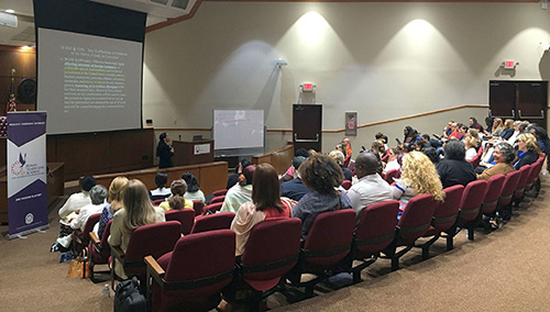 A session of the Human Trafficking Academy at St. Thomas University, taught by Barbara A. Martinez, assistant U.S. Attorney and chief of the Special Prosecutions Section in Miami.