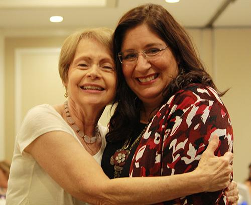 Barbara Groeber, left, education coordinator for the archdiocesan Respect Life Ministry, hugs keynote speaker Donna Gardner, Rachel's Vineyard coordinator for the Diocese of Palm Beach.