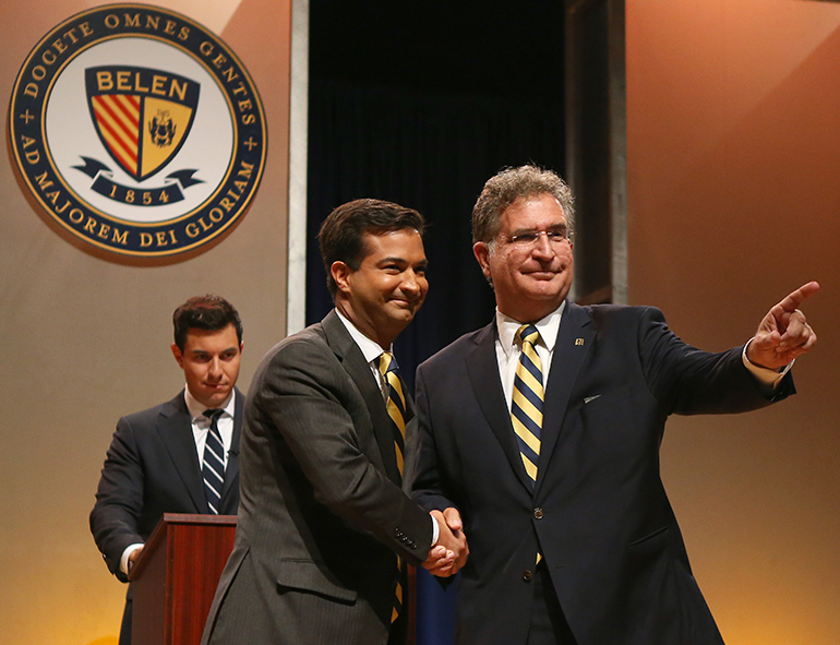 US Representative Carlos Curbelo (R-Fla), left, shakes hands with his opponent, Democrat challenger Jose Garcia, before the start of the debate at their alma mater, Belen Jesuit Preparatory School in Miami.