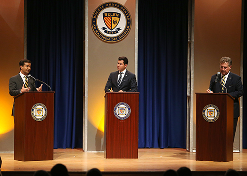 US Representative Carlos Curbelo (R-Fla), left, responds to questions from ABC News anchor and correspondent, Tom Llamas, during a debate against Democrat challenger Jose Garcia at their alma mater.