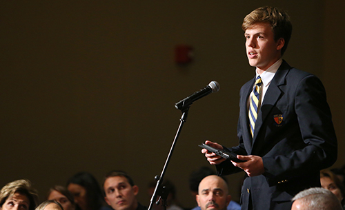 Belen student Patrick Maher asks a question to U.S. Representative Carlos Curbelo and Democrat challenger Jose Garcia.