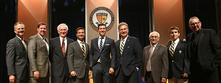Posing for a photo after the debate, from left: Belen Alumni President Antonio Castro '86, Principal Jose Roca '84, government teacher Patrick Collins, U.S. Congressman Carlos Curbelo '98, ABC News anchor and debate moderator Tom Llamas '97, former U.S. Congressman Joe Garcia '82, Alumni Executive Director Mariano Loret de Mola '58, Student Council President Alejandro Smith '17, and school President Father Guillermo Garcia-Tunon, SJ, '87.