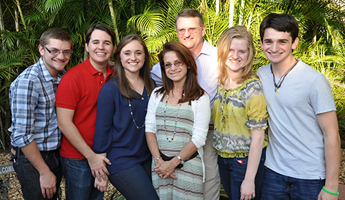 Deacon James Dugard stands behind his family. Pictured, from left: son David, son-in-law Jose Insua, daughter Katherine Insua, wife Nelly, daughter Rachel, and son James.